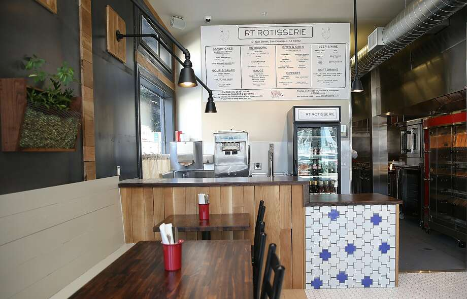 View of the inside of RT Rotisserie with menu above. Photo: Liz Hafalia, The Chronicle