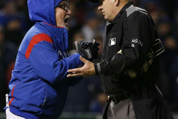 Chicago Cubs manager Joe Maddon, left, argues with home plate umpire Jeff Nelson during the sixth inning of a baseball game against the San Francisco Giants, Wednesday, May 24, 2017, in Chicago. (AP Photo/Nam Y. Huh)