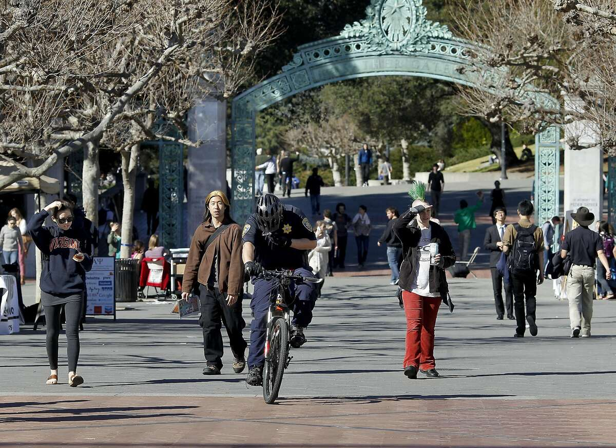 Cal Berkeley students walked past Sather Gate on the south end of campus near Telegraph Avenue. The city of Berkeley, Calif. will hold a community meeting to discuss what residents want to do about Telegraph Avenue. Officials say that students don't shop or socialize there as much as in the past.