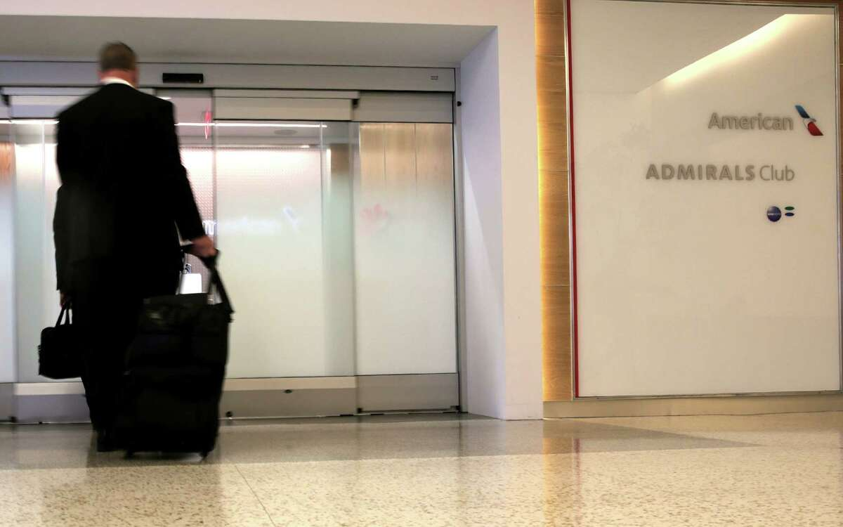 People walk into the Admirals Club for American Airlines customers at Terminal A at IAH on Wednesday, May 24, 2017, in Houston. The club has its official opening June 12. ( Elizabeth Conley / Houston Chronicle )