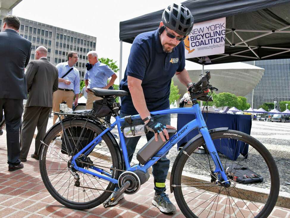 Ken Crandall, education director for the NY Bicycling Coalition explains the workings of an electric bicycle (e-bike) during a product demonstration on the Plaza at the Capitol Wednesday May 24, 2017 in Albany, NY. (John Carl D'Annibale / Times Union)