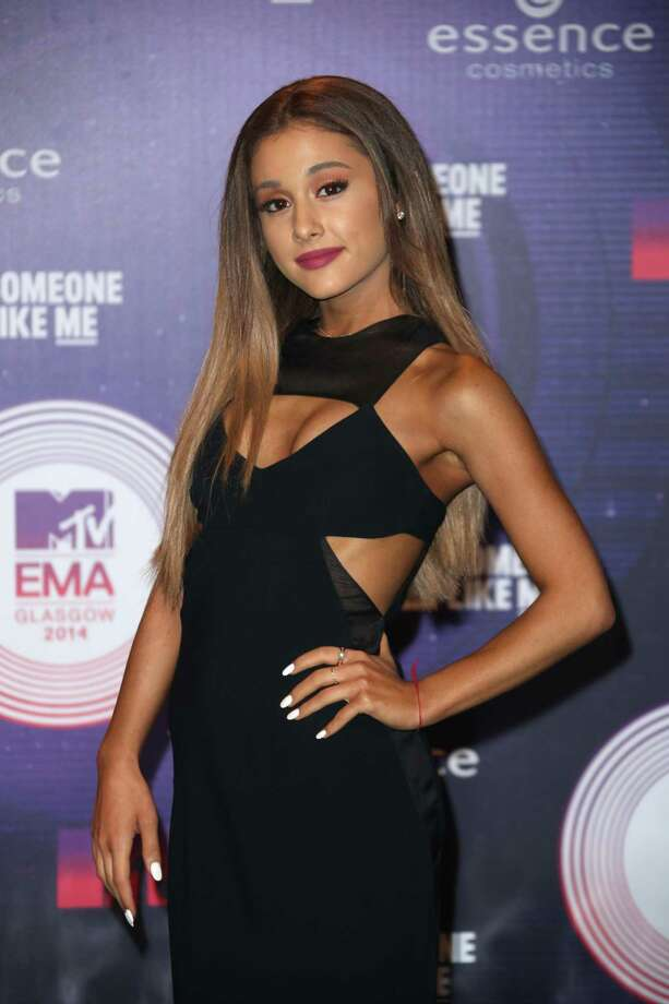 Singer Ariana Grande poses for photographers upon arrival at the 2014 MTV European Music Awards in Glasgow, Sunday, Nov. 9, 2014. (Photo by Joel Ryan/Invision/AP) ORG XMIT: LENT114 Photo: Joel Ryan / Invision