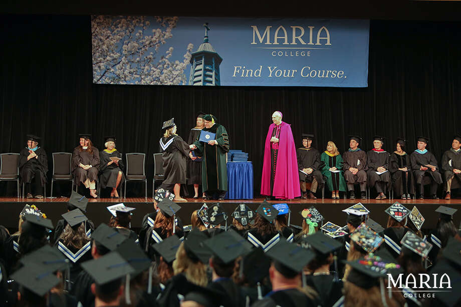 Maria College President Dr. Thomas Gamble and Bishop Emeritus Howard J. Hubbard, D.D., of the Roman Catholic Diocese of Albany, at Maria College's 55th commencement on Sunday, May 21, 2017 at the Empire State Plaza Convention Center, Albany, N.Y.. (Maria College photo)