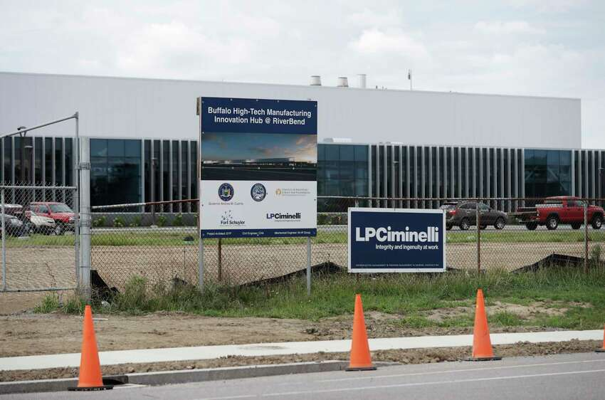 In this Wednesday, Sept. 14, 2016 photo, work continues at the high-tech manufacturing facility at the RiverBend site that will house SolarCity in Buffalo, N.Y. A federal prosecutor on Thursday, Sept. 22, 2016, charged the CEO of the contractor on the project, Louis Ciminelli, and some of his executives in a sweeping fraud and bribery case stemming from Gov. Andrew Cuomo?'s high-profile economic development projects. Joseph Percoco, Cuomo's former executive deputy secretary, and Alain Kaloyeros, president of SUNY Polytechnic Institute, are also among those who face charges, according to a criminal complaint by U.S. Attorney Preet Bharara. (AP Photo/Mike Groll) ORG XMIT: NYMG101