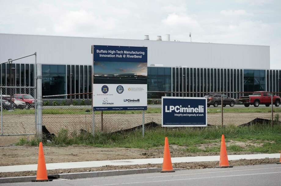 In this Wednesday, Sept. 14, 2016 photo, work continues at the high-tech manufacturing facility at the RiverBend site that will house SolarCity in Buffalo, N.Y. A federal prosecutor on Thursday, Sept. 22, 2016, charged the CEO of the contractor on the project, Louis Ciminelli, and some of his executives in a sweeping fraud and bribery case stemming from Gov. Andrew Cuomo's high-profile economic development projects. Joseph Percoco, Cuomo's former executive deputy secretary, and Alain Kaloyeros, president of SUNY Polytechnic Institute, are also among those who face charges, according to a criminal complaint by U.S. Attorney Preet Bharara. (AP Photo/Mike Groll) ORG XMIT: NYMG101 Photo: Mike Groll / Copyright 2016 The Associated Press. All rights reserved.