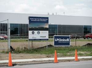 In this Wednesday, Sept. 14, 2016 photo, work continues at the high-tech manufacturing facility at the RiverBend site that will house SolarCity in Buffalo, N.Y. A federal prosecutor on Thursday, Sept. 22, 2016, charged the CEO of the contractor on the project, Louis Ciminelli, and some of his executives in a sweeping fraud and bribery case stemming from Gov. Andrew Cuomo's high-profile economic development projects. Joseph Percoco, Cuomo's former executive deputy secretary, and Alain Kaloyeros, president of SUNY Polytechnic Institute, are also among those who face charges, according to a criminal complaint by U.S. Attorney Preet Bharara. (AP Photo/Mike Groll) ORG XMIT: NYMG101