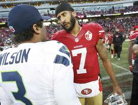 SANTA CLARA, CA - JANUARY 1: Russell Wilson #3 of the Seattle Seahawks and Colin Kaepernick #7 of the San Francisco 49ers talk on the field following the game at Levi Stadium on January 1, 2017 in Santa Clara, California. The Seahawks defeated the 49ers 25-23. (Photo by Michael Zagaris/San Francisco 49ers/Getty Images)
