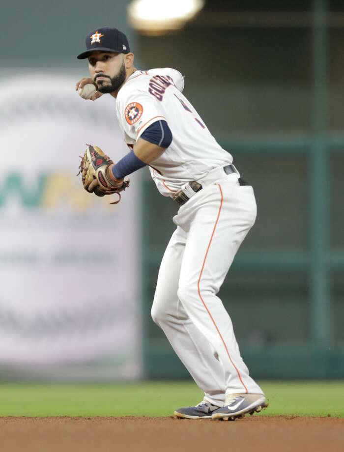 Houston Astros left fielder Marwin Gonzalez (9) gets Detroit Tigers center fielder Andrew Romine (17) out at first in the top of the seventh inning on Wednesday, May 24, 2017, in Houston. Astros lead the series 2-0. ( Elizabeth Conley / Houston Chronicle ) Photo: Elizabeth Conley/Houston Chronicle