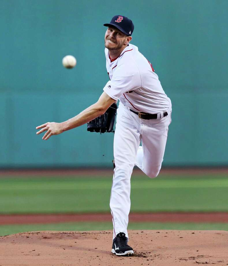 Boston Red Sox starting pitcher Chris Sale delivers during the first inning of a baseball game against the Texas Rangers at Fenway Park in Boston, Wednesday, May 24, 2017. (AP Photo/Charles Krupa) ORG XMIT: MACK104 Photo: Charles Krupa / Copyright 2017 The Associated Press. All rights reserved.