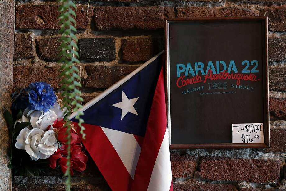 A Puerto Rican flag is displayed on the wall at Parada 22 in the Haight. Photo: Carlos Avila Gonzalez, The Chronicle