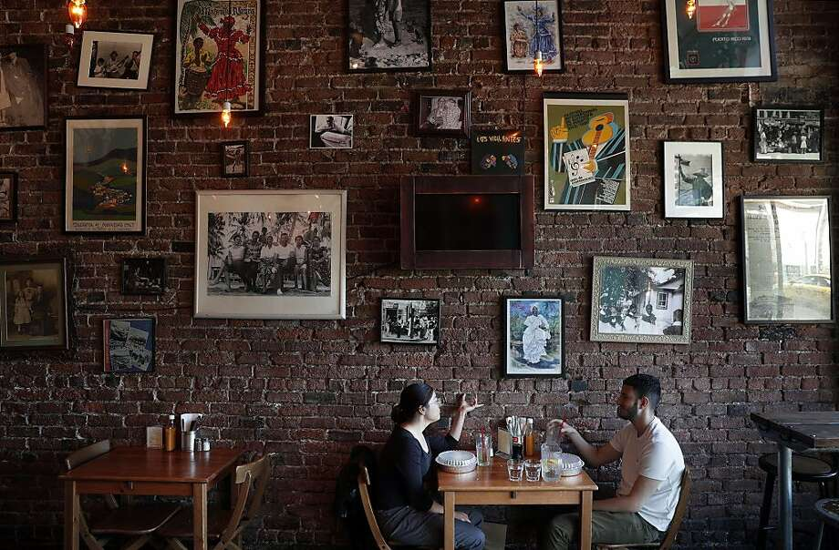 Paola Chacon and Javier Gil have lunch at Parada 22 restaurant in the Haight. Photo: Carlos Avila Gonzalez, The Chronicle