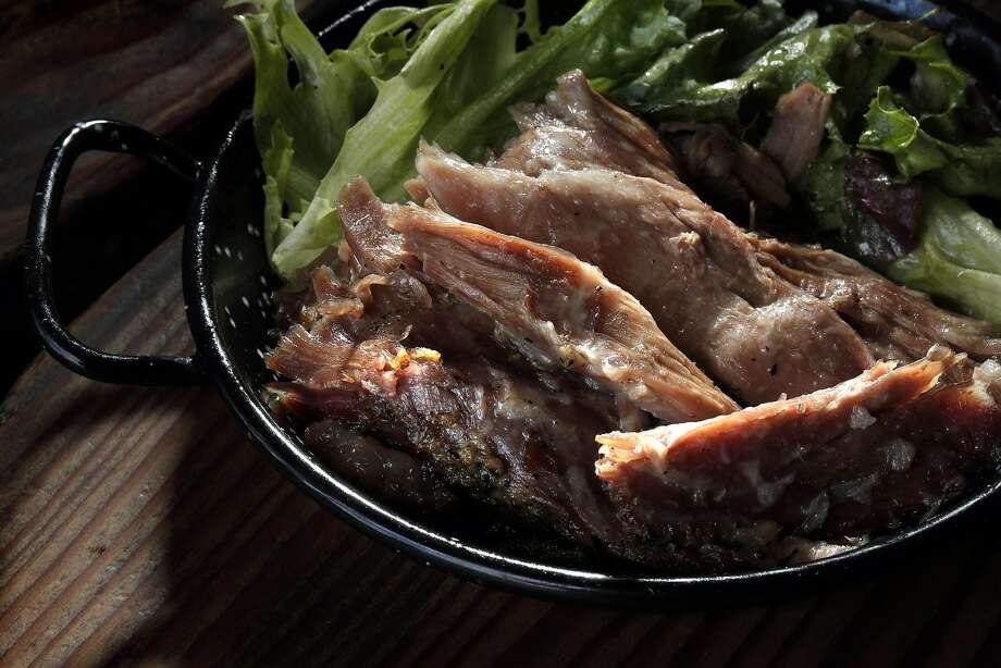 Pernil asado (slow-roasted pork marinated in garlic and oregano) at Parada 22. Photo: Carlos Avila Gonzalez, The Chronicle