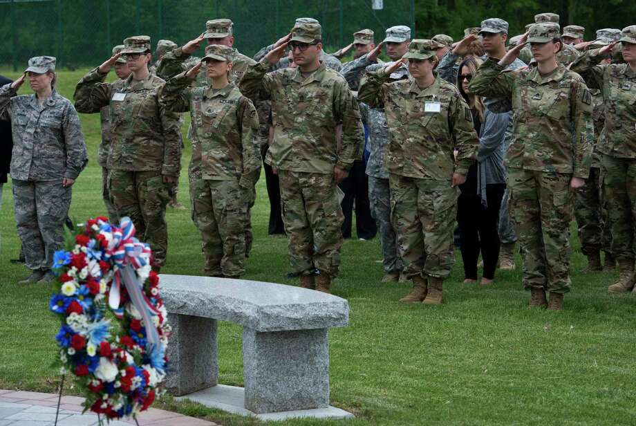 Uniformed members honor the fallen with a hand salute at the Memorial Ceremony to fallen members of the New York National Guard at the Division of Military and Naval Affairs  Wednesday May 24, in Latham, N.Y.  (Skip Dickstein/Times Union) Photo: SKIP DICKSTEIN / 20040586A