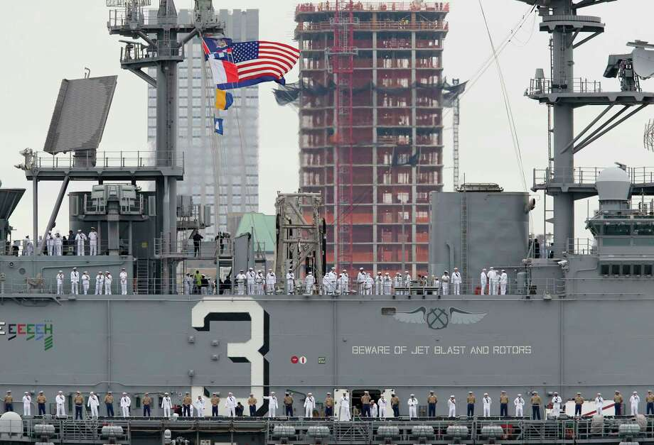 The USS Kearsarge moves past the midtown Manhattan  as part of New York's Fleet Week as seen from Weehawken, N.J., Wednesday, May 24, 2017. New York's Fleet Week kicked off with a parade of ships up the Hudson River; the public will have a chance to interact with service members and see military demonstrations through Tuesday, May 30, 2017, when the ships leave the New York area. (AP Photo/Seth Wenig) ORG XMIT: NJSW105 Photo: Seth Wenig / Copyright 2017 The Associated Press. All rights reserved.