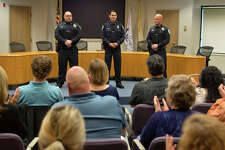 BRITTNEY LOHMILLER | blohmiller@mdn.net People gathered at City Hall applaud newly sworn-in Midland Police Officers Christopher Hurst, Jose DeLeon and James Burchfield II during an officer swearing-in ceremony Wednesday afternoon.