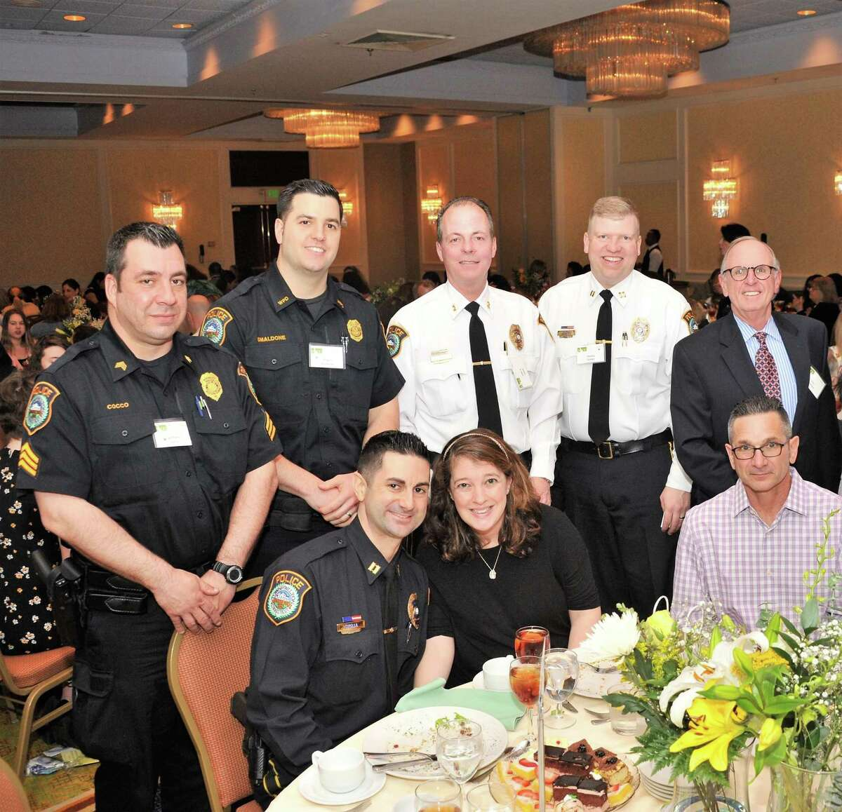 Wilton Police Sgt. Anthony Cocco, Officer Robert Smaldone, Chief John P. Lynch, Capt. Thomas Conlan, Police Commission Chairman Don Sauvigne, Capt. Rob Cipolla, Merianne Cipolla and Robert Cipolla Sr. at the Domestic Violence Crisis Center's 15th annual Spring Luncheon in Stamford on May 11.