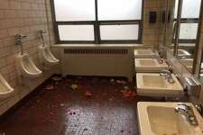Watermelons litter Fairfield Ludlowe High School bathrooms in photos attached to a Tuesday email from Headmaster Greg Hatzis to parents about a senior prank that turned to vandalism, as he described.