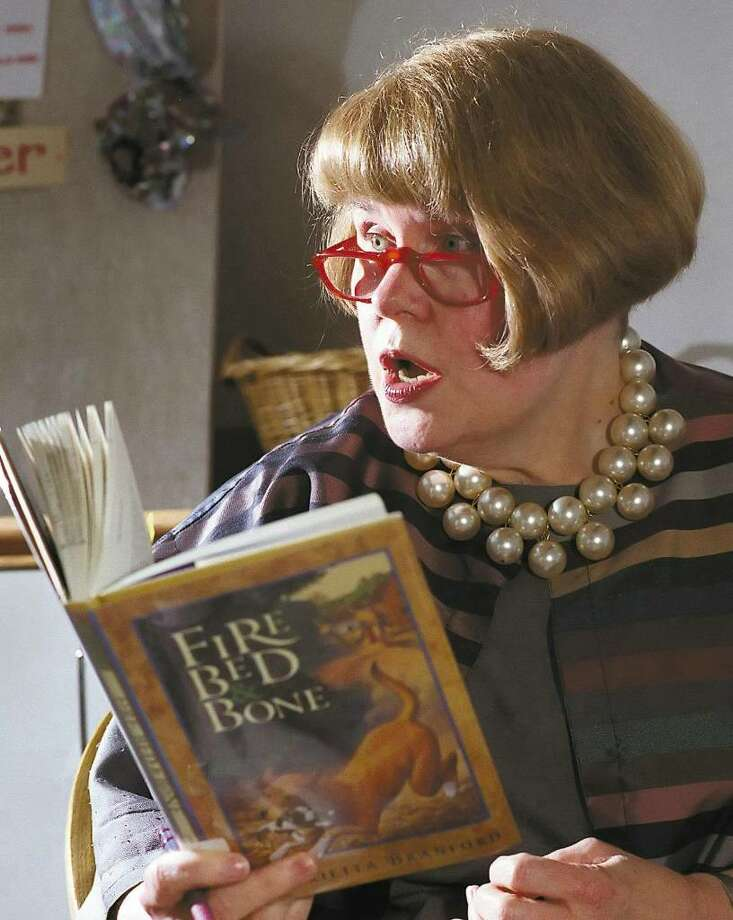 Kate McClelland is shown reading in 1998 at the Perrot Memorial Library in Old Greenwich. Photo: File Photo / Greenwich Time File Photo