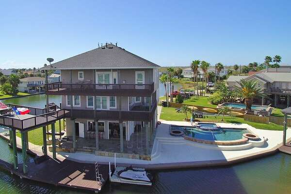 Pompano Way   $603 per night  6 bedrooms, 4 bathrooms This home in Jamaica Beach has a private pool right next to the water.    See the listing.