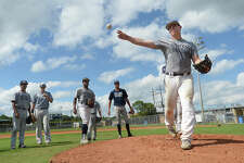 West Orange - Stark's Ryan Ragsdale fires off a throw to third from the mound as the baseball team gets in practice after school Tuesday to prepare for their 1 series playoff game Thursday against Waco Robinson. Photo taken Tuesday, May 23, 2017 Kim Brent/The Enterprise