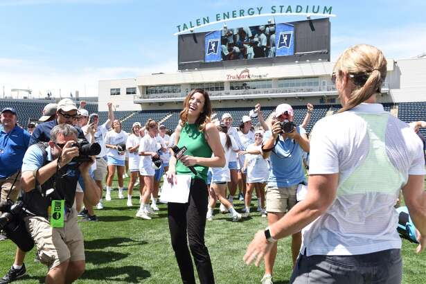 Halley Quillinan, left, a Bethlehem High graduate, gets ready to interview North Carolina coach Jenny Levy at last year's NCAA women's lacrosse championships May 29, 2016, in Chester, Pa. Quillinan worked the women's final four as a sideline reporter for ESPN. (Jaclyn Borowski / Inside Lacrosse)