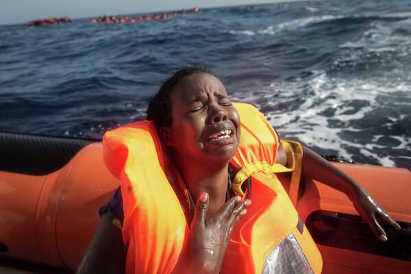 A woman cries after losing her baby in the water as she sits in a rescue boat from the Migrant Offshore Aid Station (MOAS) 'Phoenix' vessel on May 24, 2017 off Lampedusa, Italy. The Migrant Offshore Aid Station (MOAS) 'Phoenix' vessel rescued 603 people after one of three wooden boats partially capsized leaving more than 30 people dead. Numbers of refugees and migrants attempting the dangerous central Mediterranean crossing from Libya to Italy has risen since the same time last year with more than 43,000 people recorded so far in 2017. In an attempt to slow the flow of migrants Italy recently signed a deal with Libya, Chad and Niger outlining a plan to increase border controls and add new reception centers in the African nations, which are key transit points for migrants heading to Italy. MOAS is a Malta based NGO dedicated to providing professional search-and-rescue assistance to refugees and migrants in distress at sea. Since the start of the year MOAS have rescued and assisted 3572 people and are currently patrolling and running rescue operations in international waters off the coast of Libya.  (Photo by Chris McGrath/Getty Images)
