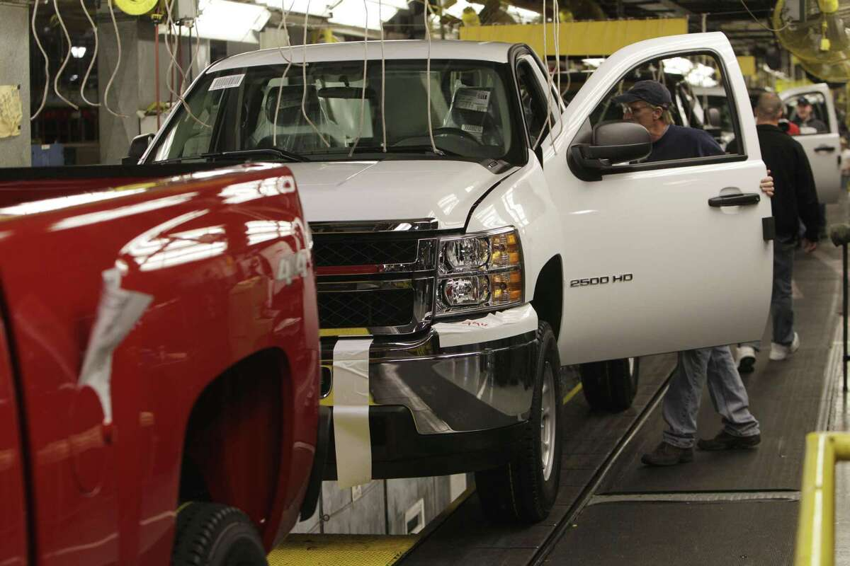 General Motors Silverado and GMC Sierra pickup trucks on the assembly line in Michigan, in February 2011. (AP Photo/Carlos Osorio, file)