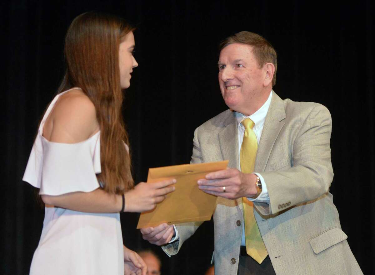 Chris Eidt presents Gracie Bradley with the Kevin M. Eidt Memorial Scholarship on Wednesday, May 24, 2017 during Norwalk High School Awards Night. The scholarship is for a student with outstanding achievement across the spectrum of academics, athletics, arts, and community and religious service.