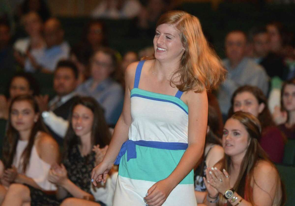 Isabel Nees smiles as she goes to accept the Kevin M. Eidt Orchestra Scholarship on Wednesday, May 24, during Norwalk High School Awards Night. The scholarship is for a student member of the orchestra who has made an outstanding contribution musically and as arole model to others.
