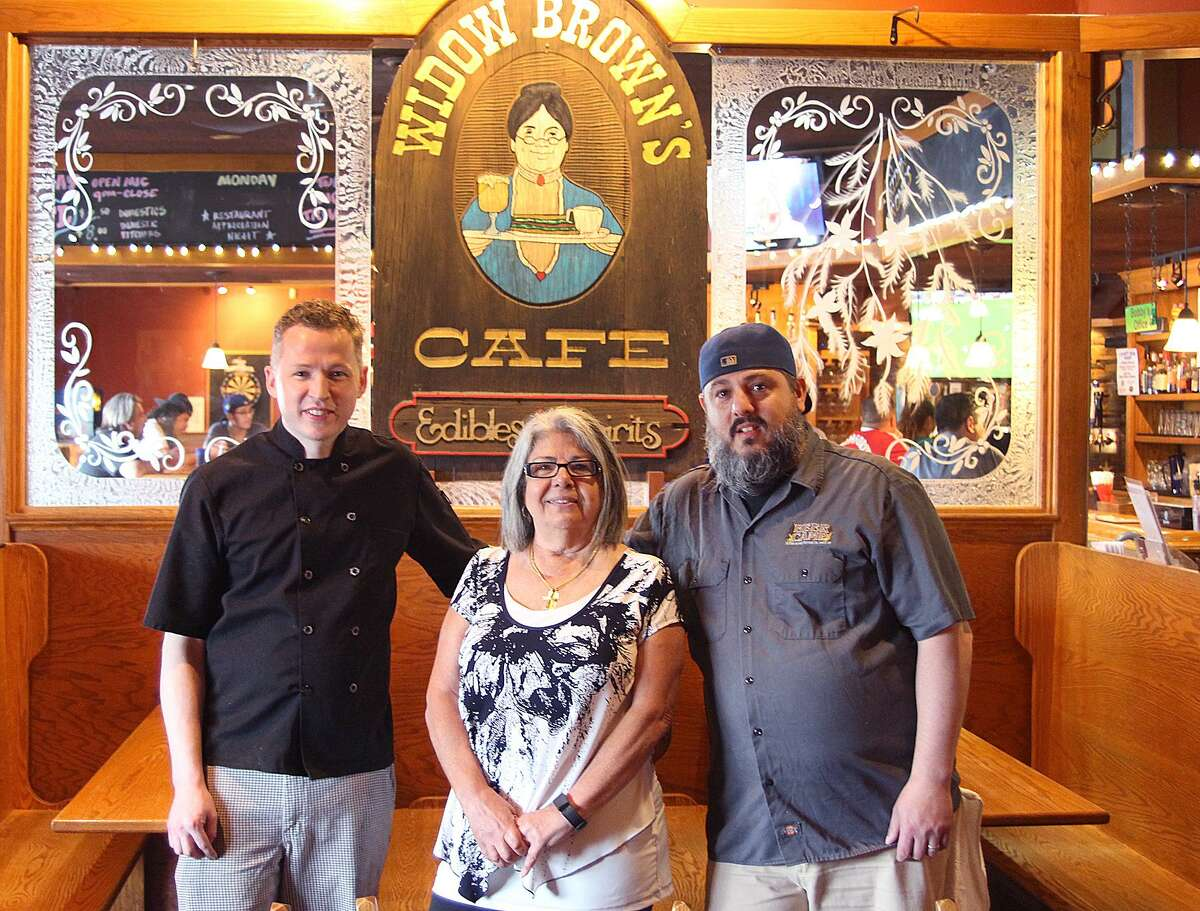 Widow Brown's Cafe Head Chef Joe Hawkes, Owner Aura Showah, and General Manager J.T. Wilson sit in the 40-year-old establishment on Wednesday, May 24, 2017, on Federal Road in Danbury, Conn.