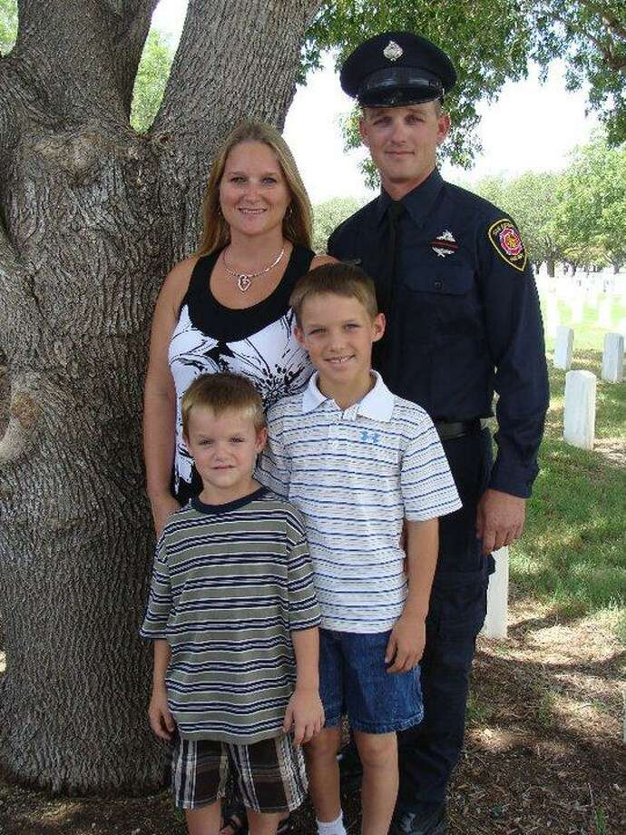 Brad Phipps, who was critically injured earlier this year in a fire that claimed the life of another firefighter, is pictured in a family photo with his wife, Tina, and two sons. Phipps is finally out of the ICU after two months and 19 surgeries. Photo: Courtesy Photo