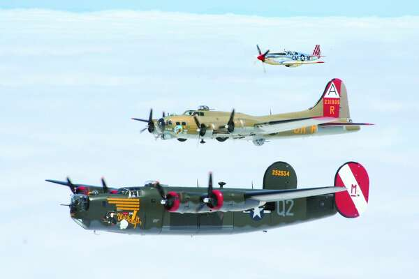 A courtesy photo from the Collings Foundation shows a B-24 Liberator, B-17 Flying Fortress and P-51 Mustang in formation.