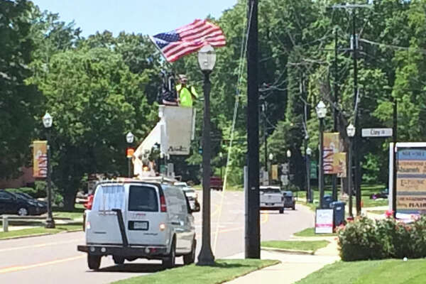 Crews were out Thursday afternoon decorating lamp posts with American flags in preparation for Memorial Day. Services will be conduct at 9 a.m. Monday at the Glen Carbon Veterans Monument and at 10 a.m. at Woodlawn Cemetery.