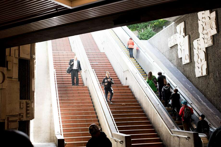 "FILE – BART riders enter the 24th Street Mission Station in this May 24, 2017 file photo taken in San Francisco. The 24th St. Mission BART station is closed due to a ""major medical emergency,"" the transit agency reported on Twitter on Thursday evening. Photo: Noah Berger, Special To The Chronicle"
