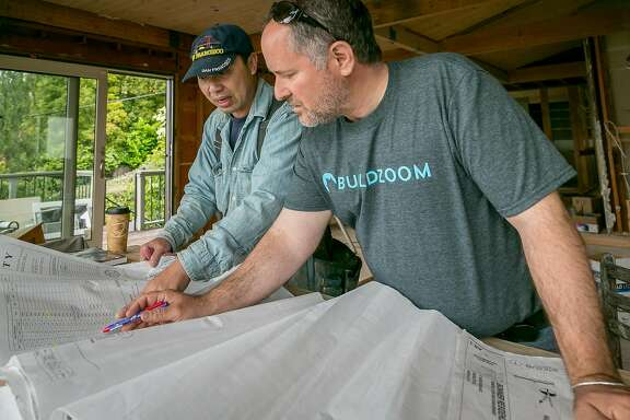 Contractor Adam Barnum goes over plans with his foreman Jeffrey Chow for a home remodel in Sausalito, Calif., on May 25th, 2017.