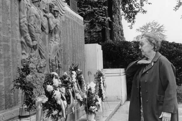 Nellie Gray, Gold Star mother of Midland, pays honor to the war dead at the Veterans Memorial. May 1975