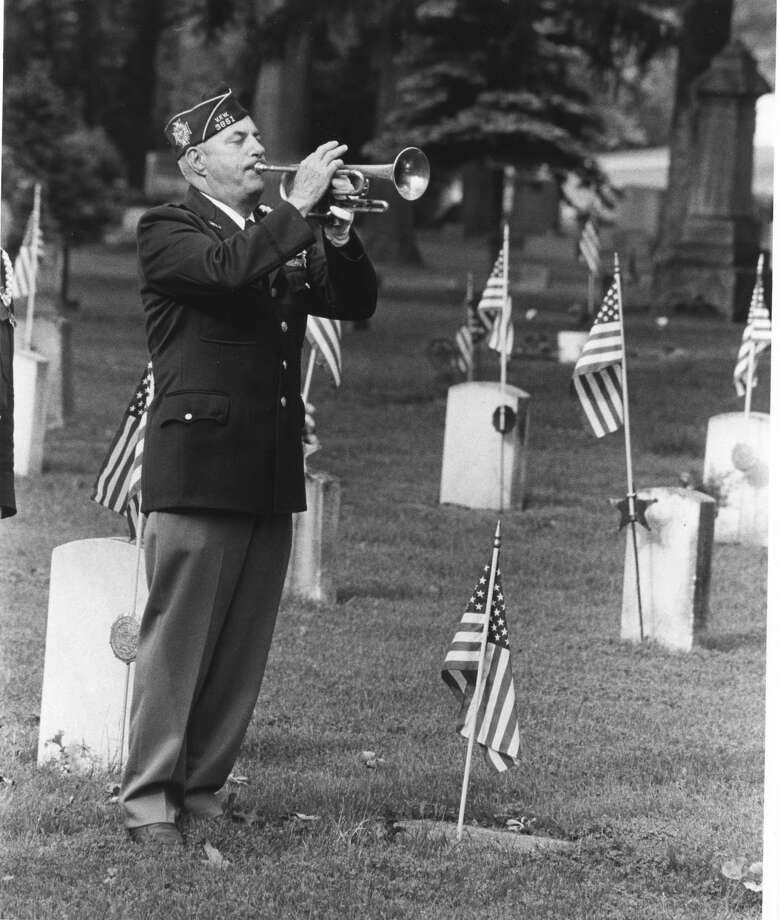 George Marshall's bugle closes the services conducted by the VFW at Midland Cemetery on Memorial Day. May 1986 Photo: Daily News File Photo