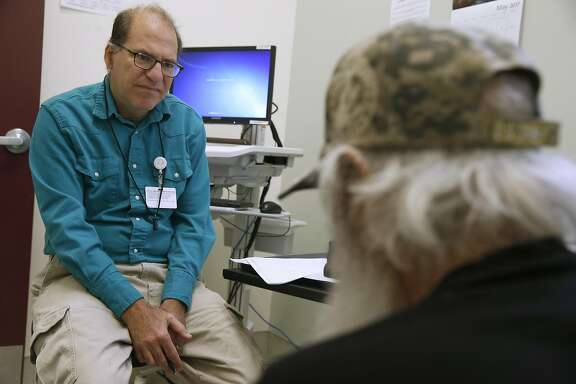Dr. Barry Zevin meets with a patient at the Homeless Outreach Team street medicine clinic in San Francisco, Calif. on Thursday, May 25, 2017.