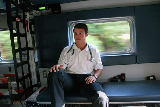 Robbie Waters rides in the back of a Post 53 ambulance on July 27 in Darien.