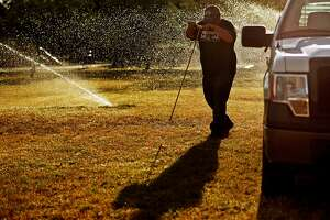 Josh Firkins, an irrigation tech with the City of Midland, probes the ground looking for a water line while inspecting and testing the irrigation system at Grafa Park on May 25, 2017. City employees are ensuring the parks and watering systems are ready for the hot summer months, according Sara Bustilloz, Public Information Officer for the City of Midland. James Durbin/Reporter-Telegram