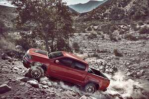 The Colorado ZR2's standard AutoTrac transfer case and front and rear locking differentials give the driver nine configurations to select, ranging from 2WD to 4WD Lo with the transfer case and both diffs locked and loaded. A bed-mounted tire carrier is an option-click away.