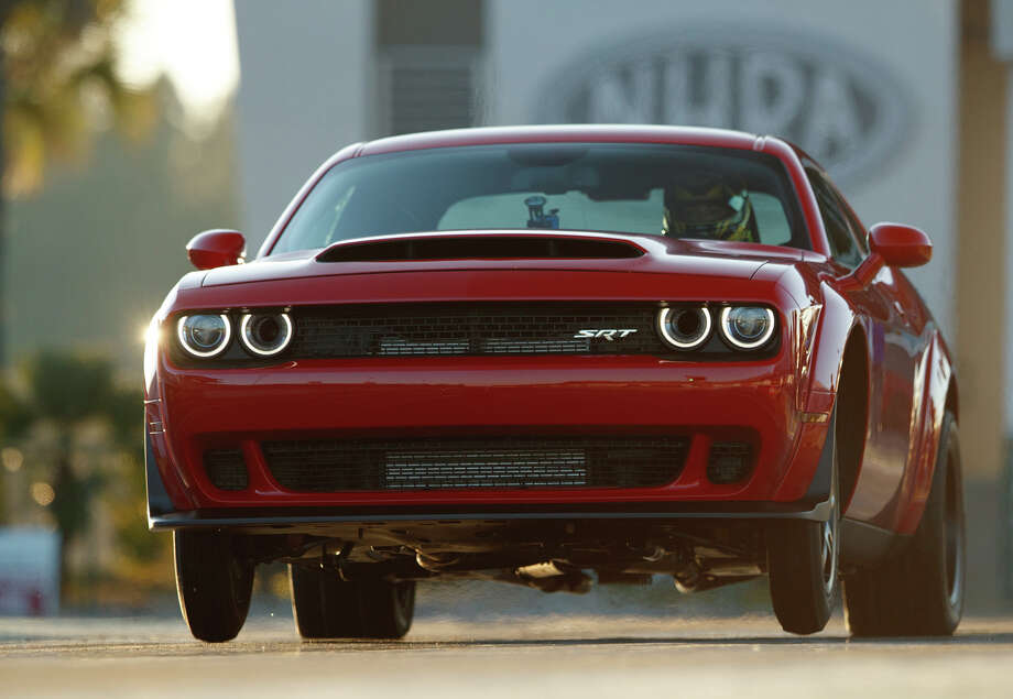 The 2018 Dodge Challenger SRT Demon is in the history books for the longest wheelie from a standing start by a production car:  2.92 feet. The feat was certified by Guinness World Records. Photo: Dodge / © 2017 FCA US LLC