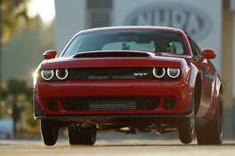 The 2018 Dodge Challenger SRT Demon is in the history books for the longest wheelie from a standing start by a production car:  2.92 feet. The feat was certified by Guinness World Records.