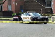 The shooting at the Greene Homes apartment complex was just one of two shootings that occurred on Wednesday, May 24, 2017,  in Bridgeport, Conn. This photo shows the crime scene blocked off at Greene Homes complex early afternoon. The second shooting was fatal and occurred on Railroad Avenue by Went Field Park.