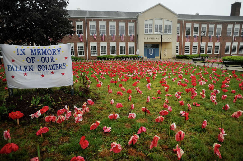 Over four thousand poppies decorate the front lawn of Eli Whitney School at 1130 Huntington Road in Stratford, Conn. in honor of Memorial Day on Thursday, May 25, 2017. Photo: Brian A. Pounds, Hearst Connecticut Media / Connecticut Post