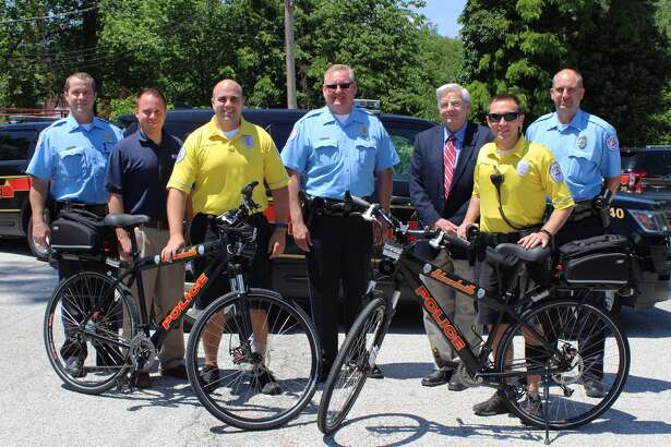 Edwardsville Police officials pose with Madison County Transit after receiving two police patrol bike donations. This is the second donation MCT has made to the bike patrol program thus far.