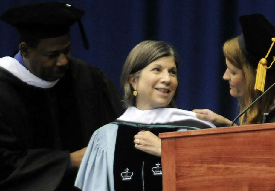 Pulitzer Prize winng columnist Anna Quindlen, center, recieves an honorary Doctor of Humane Letters degree during The Sage Colleges commencement at RPI in Troy N.Y. Saturday May 12, 2012. (Michael P. Farrell/Times Union) Photo: Michael P. Farrell / 00017199A