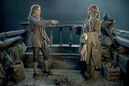 "L-r): Brenton Thwaites (Henry) and Johnny Depp (Captain Jack Sparrow) in ""Pirates of the Caribbean: Dead Men Tell No Tales."" MUST CREDIT: Peter Mountain, Walt Disney Studios"