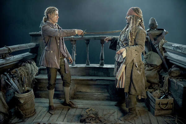 """L-r): Brenton Thwaites (Henry) and Johnny Depp (Captain Jack Sparrow) in """"Pirates of the Caribbean: Dead Men Tell No Tales."""" MUST CREDIT: Peter Mountain, Walt Disney Studios"""