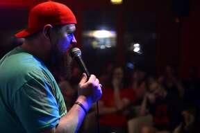 Comedian Justin Thompson performs at the comedy open mic night at Jerusalem Hookah Cafe.  Photo taken Thursday 5/11/17 Ryan Pelham/The Enterprise